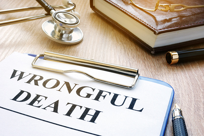 Wrongful death claim form next to a stethoscope on a table