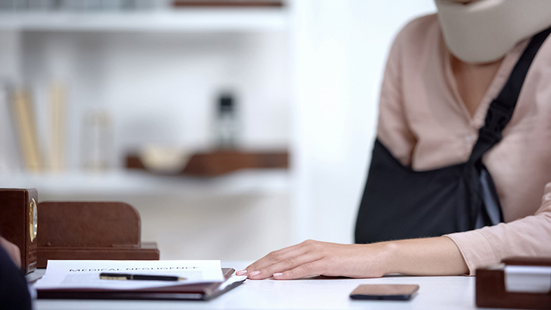 Injured woman speaks with a personal injury attorney about recovering compensation