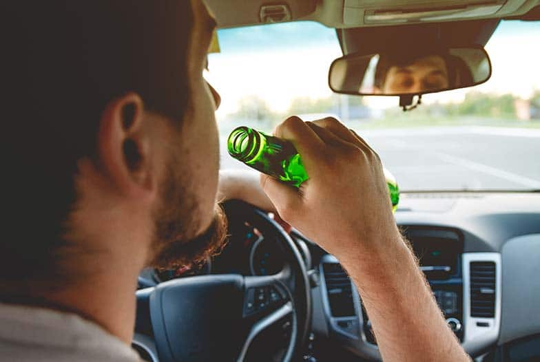 Wisconsin man driving and drinking a beer