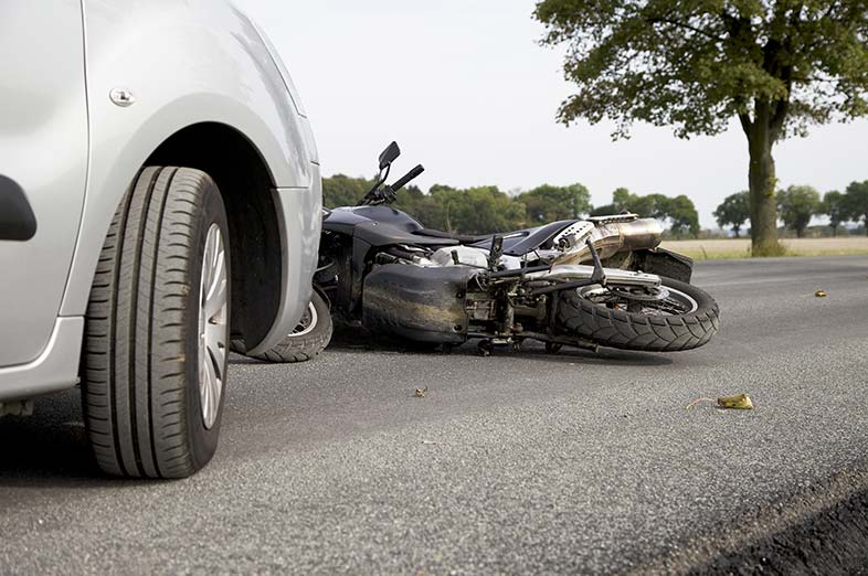 A black motorcycle on a Wisconsin road after collision with a car